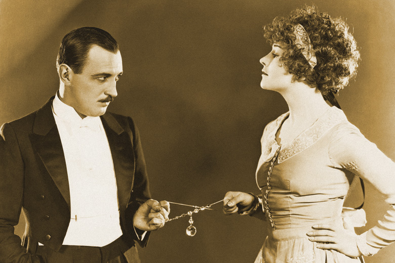 couple-in-tug-of-war-with-necklace