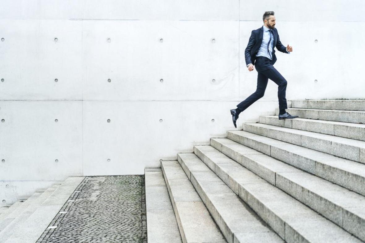 1200-84584371-man-running-on-stairs